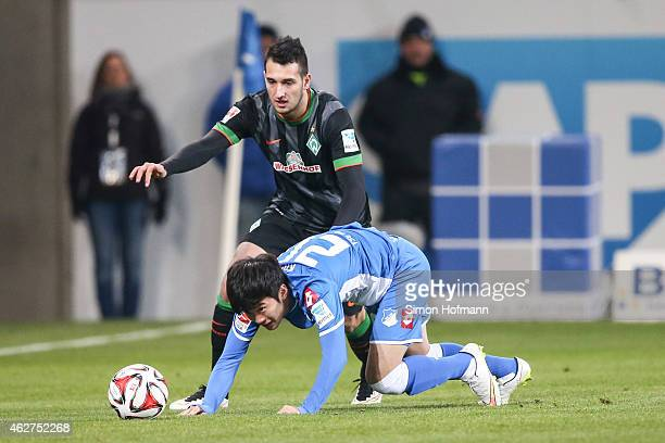 JinSu Kim of Hoffenheim is challenged by Levin Oeztunali of Bremen during the Bundesliga match between TSG 1899 Hoffenheim and SV Werder Bremen at...