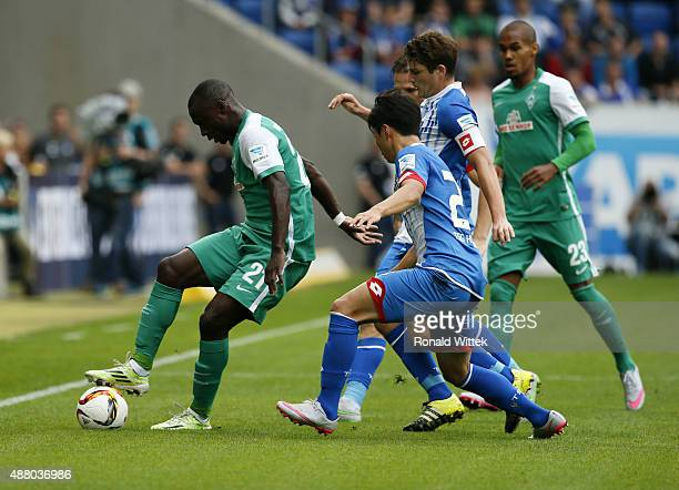 JinSu Kim Pavel Kaderabek of Hoffenheim and Anthony Ujah of Bremen compete for the ball during the Bundesliga match between 1899 Hoffenheim and SV...