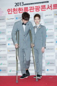 Jinwoon and Jo Kwon of South Korean boy band 2AM attend the '2013 Incheon Korean Music Wave' Photocall at Incheon Munhak Stadium on September 1 2013...