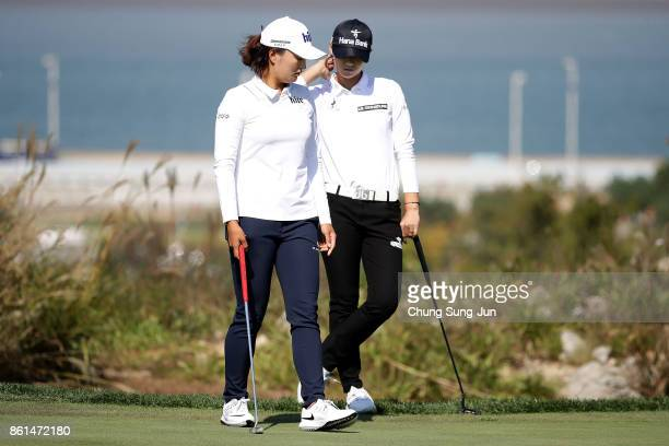 JinYoung Ko and SungHyun Park of South Korea on the 6th green during the final round of the LPGA KEB Hana Bank Championship at the Sky 72 Golf Club...