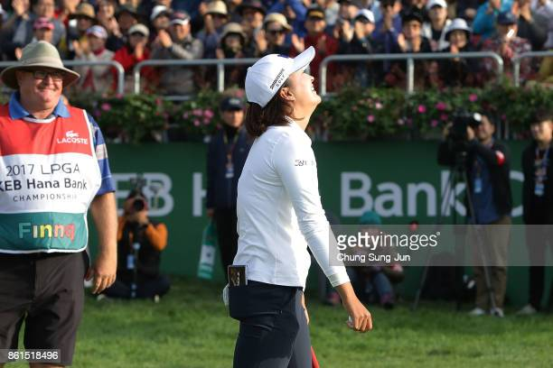 JinYoung Ko of South Korea celebrates after a winning putt on the 18th green during the final round of the LPGA KEB Hana Bank Championship at the Sky...