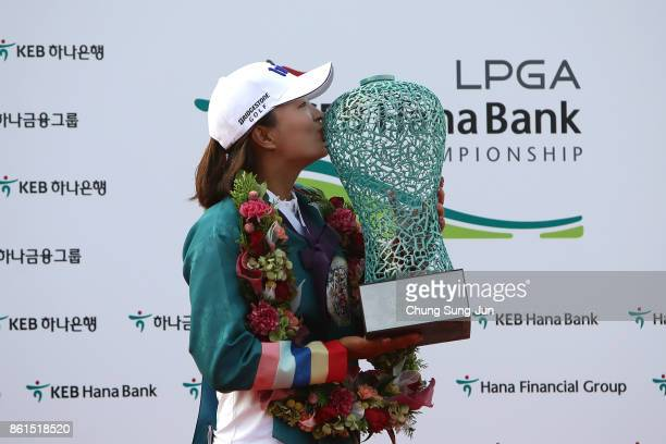 JinYoung Ko of South Korea kisses the winners trophy during a ceremony following the LPGA KEB Hana Bank Championship at the Sky 72 Golf Club Ocean...