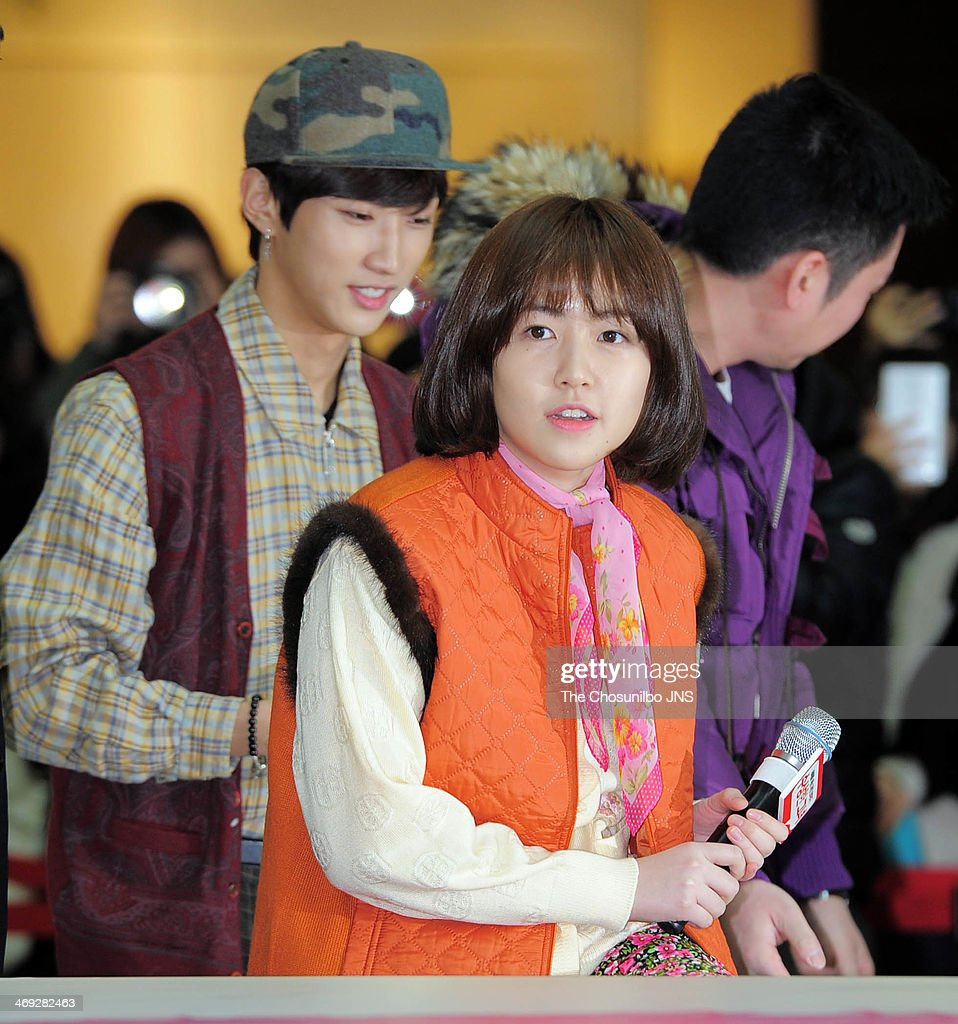 JinYoung of B1A4 and Sim EunKyung attend the movie 'Miss Granny' free hug event at Times Square on February 13 2014 in Seoul South Korea