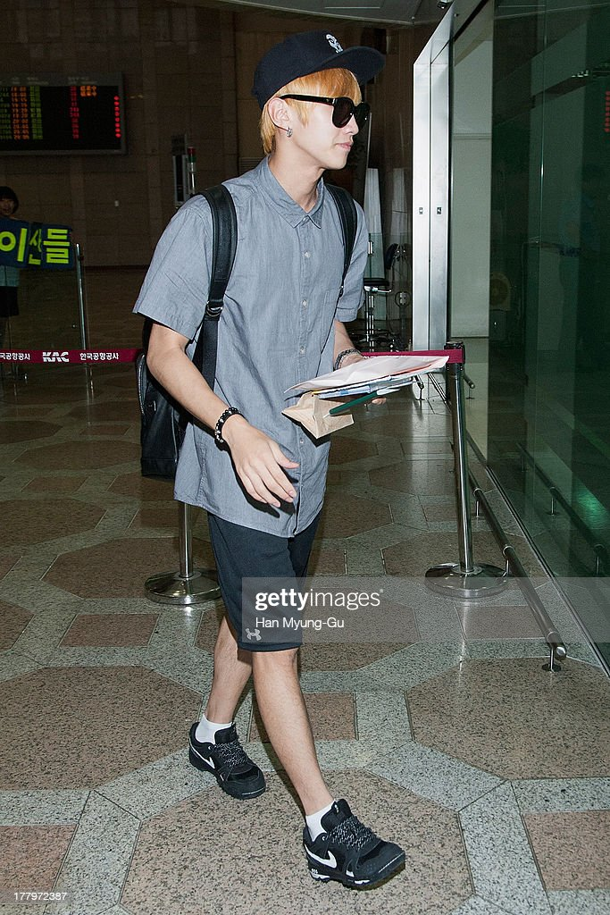 Jinyoung of South Korean boy band B1A4 is seen on departure at Gimpo International Airport on August 26, 2013 in Seoul, South Korea.