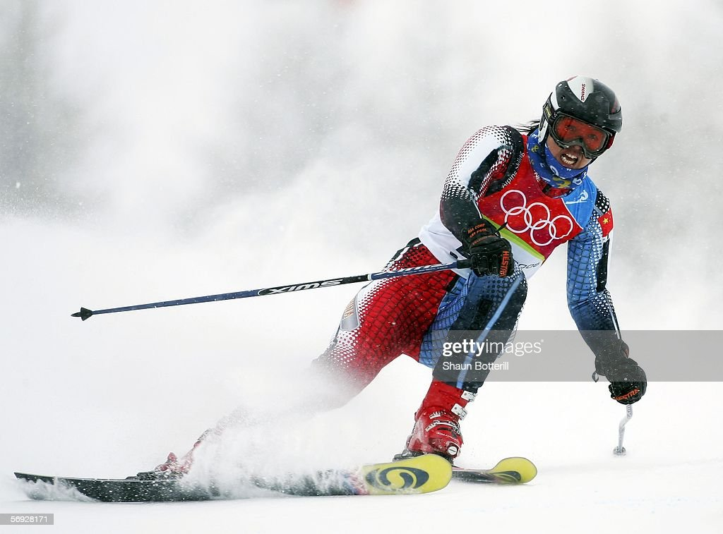 Jinzhi Dong of China competes in the second run of the Final of the Womens Alpine Skiing Giant Slalom on Day 14 of the 2006 Turin Winter Olympic...