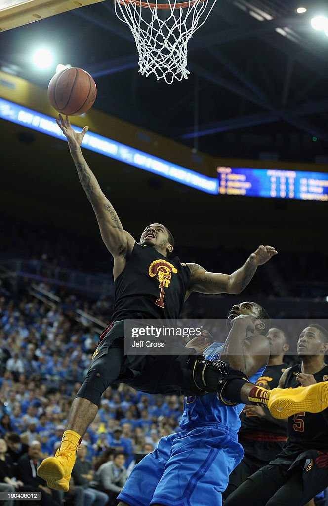 Jio Fontan #1 of the USC Trojans drives to the basket while pursued by <a gi-track='captionPersonalityLinkClicked' href=/galleries/search?phrase=Shabazz+Muhammad&family=editorial&specificpeople=7447677 ng-click='$event.stopPropagation()'>Shabazz Muhammad</a> #15 of the UCLA Bruins in the first half at Pauley Pavilion on January 30, 2013 in Los Angeles, California.