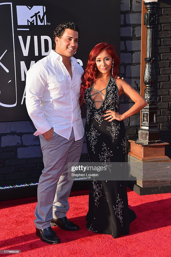 Jionni LaValle and Nicole 'Snooki' Polizzi attend the 2013 MTV Video Music Awards at the Barclays Center on August 25, 2013 in the Brooklyn borough of New York City.