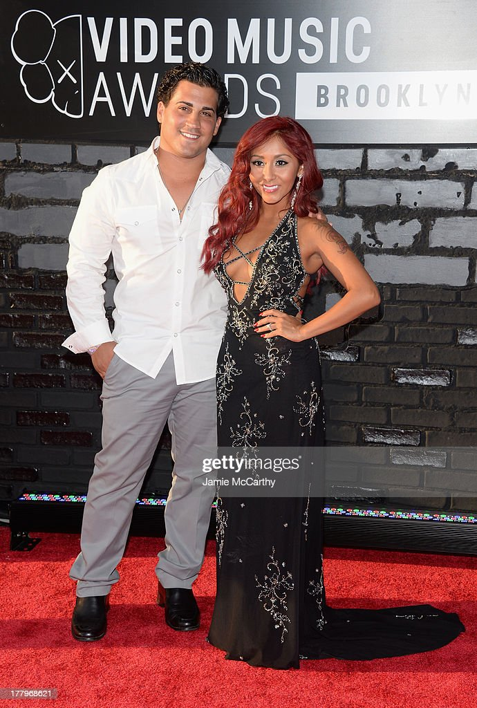 Jionni LaValle and Nicole 'Snooki' Polizzi attends the 2013 MTV Video Music Awards at the Barclays Center on August 25, 2013 in the Brooklyn borough of New York City.