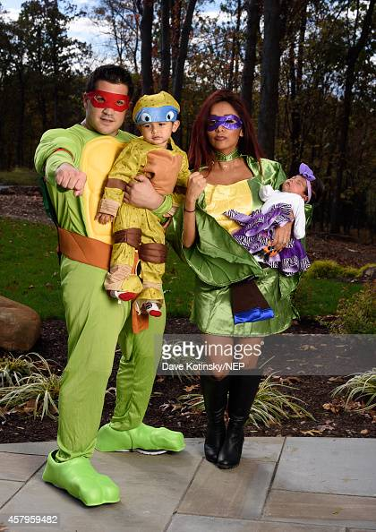 Jionni LaValle Lorenzo LaValle Giovanna Marie LaValle and Nicole 'Snooki' Polizzi in their Teenage Mutant Ninja Costumes from Rubie's Costumes as...