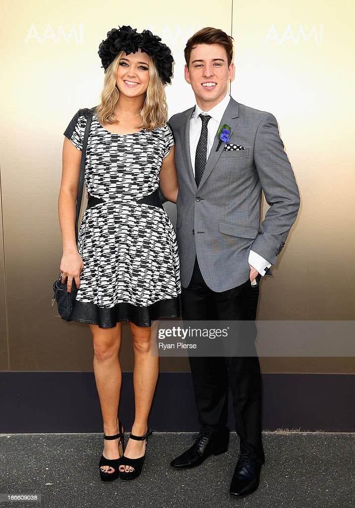 Jiordan Tolli and Taylor Henderson arrive on Victoria Derby Day at Flemington Racecourse on November 2, 2013 in Melbourne, Australia.