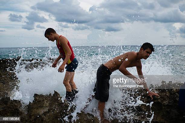 Jiradel Garrido left and Hector Carmona collect snails for food Garrido lives in the sparsely populated and once english speaking village of...
