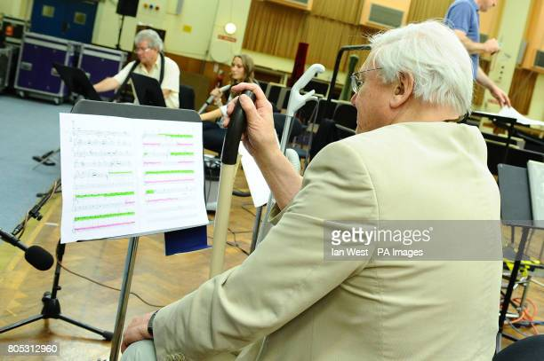 Jiri Belohlavek Jennifer Pike both playing hoovers and Sir David Attenborough with a floor polisher during a rehearsal for Sir Malcolm Arnold's 'A...