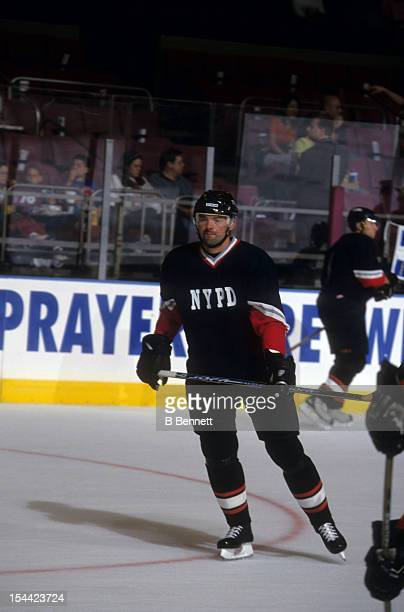 Jiri Dopita of the Philadelphia Flyers wears an NYPD jersey to support the victims of the September 11 attacks on New York City in September 2001 at...