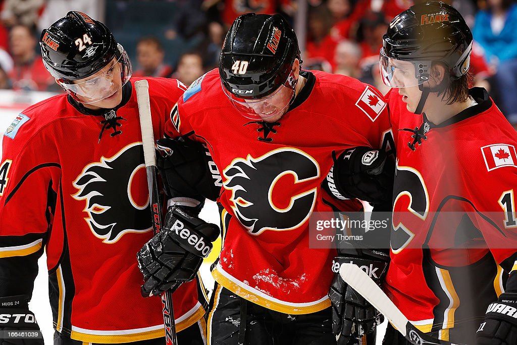 <a gi-track='captionPersonalityLinkClicked' href=/galleries/search?phrase=Jiri+Hudler&family=editorial&specificpeople=2118675 ng-click='$event.stopPropagation()'>Jiri Hudler</a> #24 and <a gi-track='captionPersonalityLinkClicked' href=/galleries/search?phrase=Mikael+Backlund&family=editorial&specificpeople=4324942 ng-click='$event.stopPropagation()'>Mikael Backlund</a> #11 help <a gi-track='captionPersonalityLinkClicked' href=/galleries/search?phrase=Alex+Tanguay&family=editorial&specificpeople=203231 ng-click='$event.stopPropagation()'>Alex Tanguay</a> #40 of the Calgary Flames off the ice after being injured against the Phoenix Coyotes on April 12, 2013 at the Scotiabank Saddledome in Calgary, Alberta, Canada.