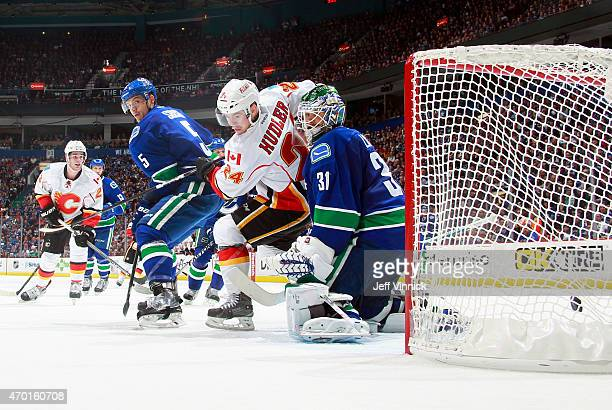 Jiri Hudler of the Calgary Flames and Luca Sbisa screened Eddie Lack of the Vancouver Canucks when the Flames scored during Game Two of the Western...