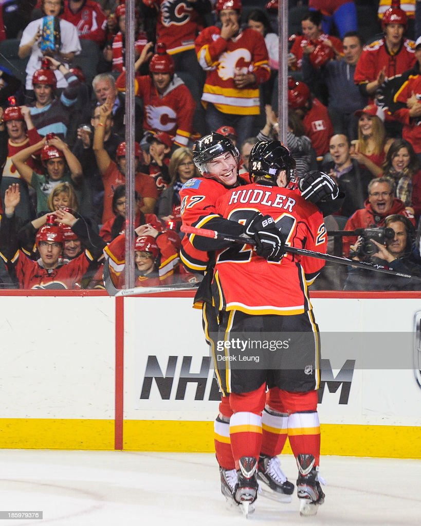 Jiri Hudler #24 of the Calgary Flames celebrates scoring the team's second goal against the Washington Capitals along with his teammate Sven Baertschi #47 during an NHL game at Scotiabank Saddledome on October 26, 2013 in Calgary, Alberta, Canada.