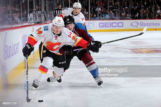 Jiri Hudler of the Calgary Flames controls the puck against Matt Duchene of the Colorado Avalanche at Pepsi Center on November 3 2015 in Denver...