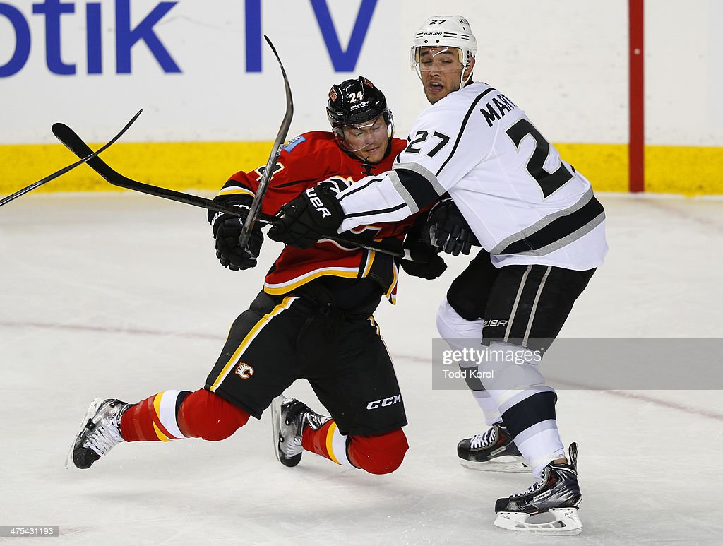 <a gi-track='captionPersonalityLinkClicked' href=/galleries/search?phrase=Jiri+Hudler&family=editorial&specificpeople=2118675 ng-click='$event.stopPropagation()'>Jiri Hudler</a> (L) of the Calgary Flames crashes into <a gi-track='captionPersonalityLinkClicked' href=/galleries/search?phrase=Alec+Martinez&family=editorial&specificpeople=5537193 ng-click='$event.stopPropagation()'>Alec Martinez</a> of the Los Angeles Kings during the third period of their NHL hockey game at the Scotiabank Saddledome February 27, 2014 in Calgary, Alberta, Canada.