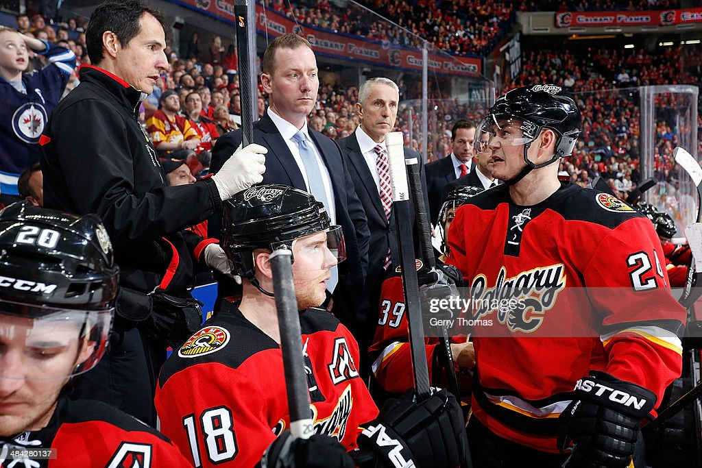 <a gi-track='captionPersonalityLinkClicked' href=/galleries/search?phrase=Jiri+Hudler&family=editorial&specificpeople=2118675 ng-click='$event.stopPropagation()'>Jiri Hudler</a> #24 of the Calgary Flames exchanges sticks in between shifts against the Winnipeg Jets at Scotiabank Saddledome on April 11, 2014 in Calgary, Alberta, Canada.