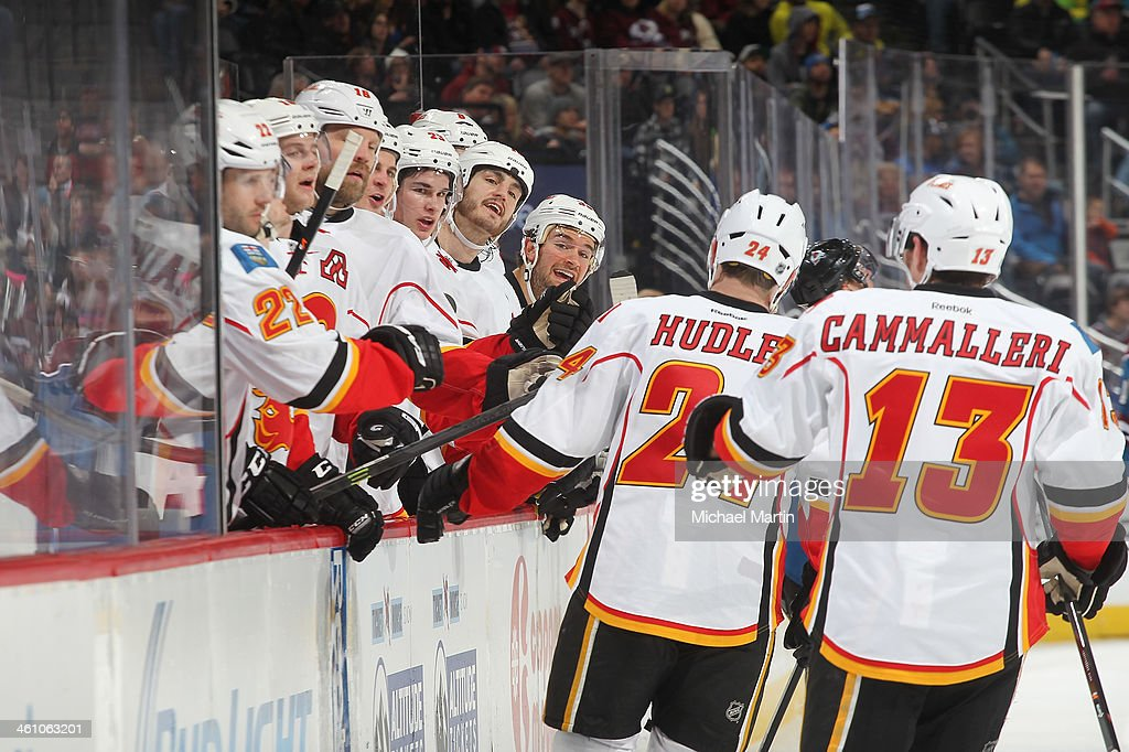 <a gi-track='captionPersonalityLinkClicked' href=/galleries/search?phrase=Jiri+Hudler&family=editorial&specificpeople=2118675 ng-click='$event.stopPropagation()'>Jiri Hudler</a> #24 of the Calgary Flames is greeted by teammates after scoring against the Colorado Avalanche at the Pepsi Center on January 06, 2014 in Denver, Colorado.