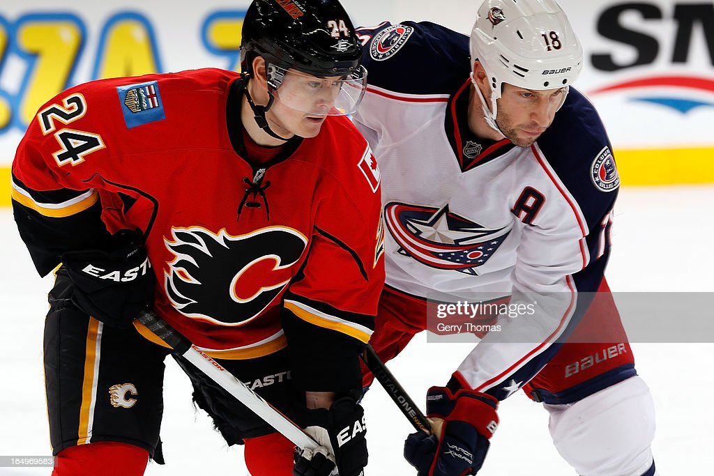 <a gi-track='captionPersonalityLinkClicked' href=/galleries/search?phrase=Jiri+Hudler&family=editorial&specificpeople=2118675 ng-click='$event.stopPropagation()'>Jiri Hudler</a> #24 of the Calgary Flames lines up for a faceoff against RJ Umberger #18 of the Columbus Blue Jackets on March 29, 2013 at the Scotiabank Saddledome in Calgary, Alberta, Canada.