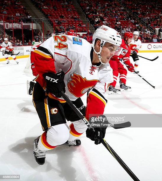 Jiri Hudler of the Calgary Flames plays the a puck in the corner during their NHL game against the Carolina Hurricanes at PNC Arena on November 10...