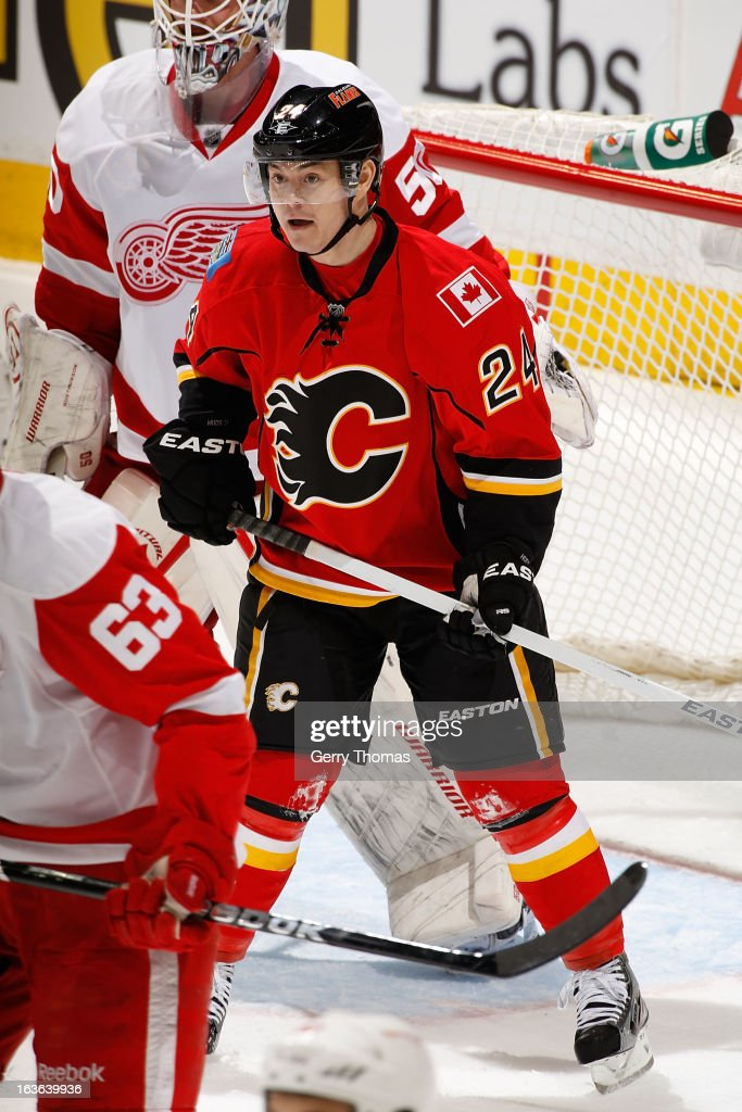 <a gi-track='captionPersonalityLinkClicked' href=/galleries/search?phrase=Jiri+Hudler&family=editorial&specificpeople=2118675 ng-click='$event.stopPropagation()'>Jiri Hudler</a> #24 of the Calgary Flames positions himself in front of goalie <a gi-track='captionPersonalityLinkClicked' href=/galleries/search?phrase=Jonas+Gustavsson&family=editorial&specificpeople=886789 ng-click='$event.stopPropagation()'>Jonas Gustavsson</a> #50 of the Detroit Red Wings on March 13, 2013 at the Scotiabank Saddledome in Calgary, Alberta, Canada.