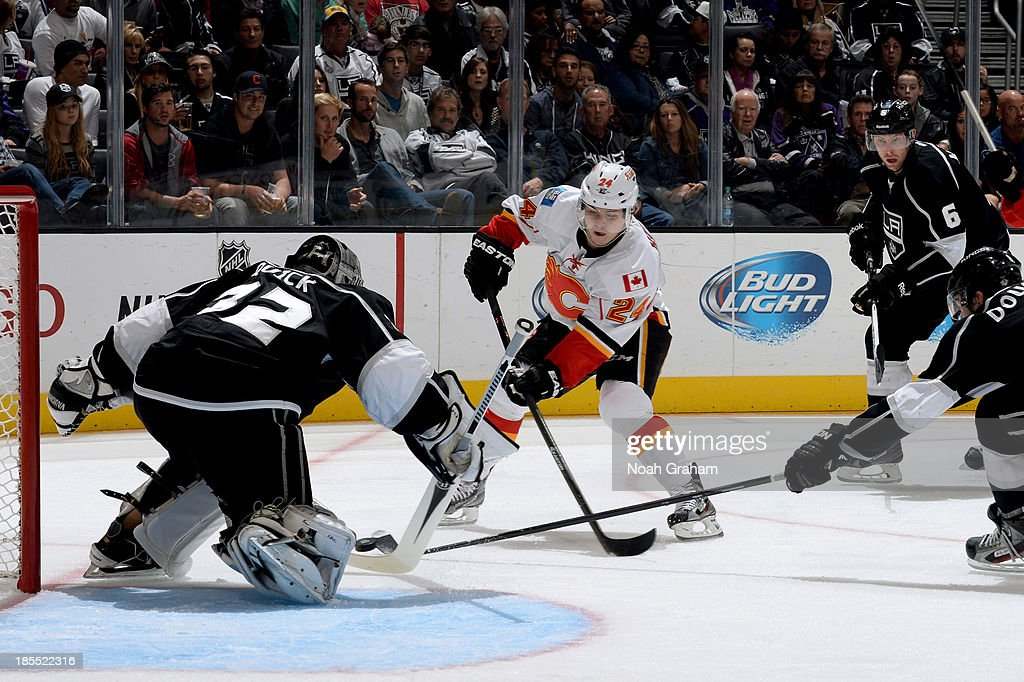 <a gi-track='captionPersonalityLinkClicked' href=/galleries/search?phrase=Jiri+Hudler&family=editorial&specificpeople=2118675 ng-click='$event.stopPropagation()'>Jiri Hudler</a> #24 of the Calgary Flames shoots the puck against <a gi-track='captionPersonalityLinkClicked' href=/galleries/search?phrase=Jonathan+Quick&family=editorial&specificpeople=2271852 ng-click='$event.stopPropagation()'>Jonathan Quick</a> #32 of the Los Angeles Kings at Staples Center on October 21, 2013 in Los Angeles, California.