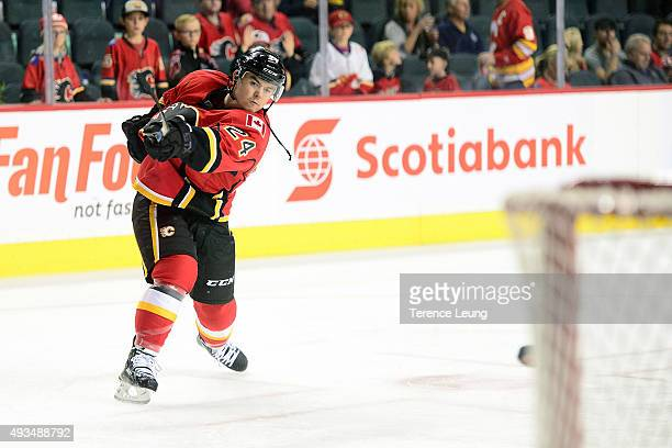 Jiri Hudler of the Calgary Flames shoots the puck in warmups against the Washington Capitals during an NHL game at Scotiabank Saddledome on October...