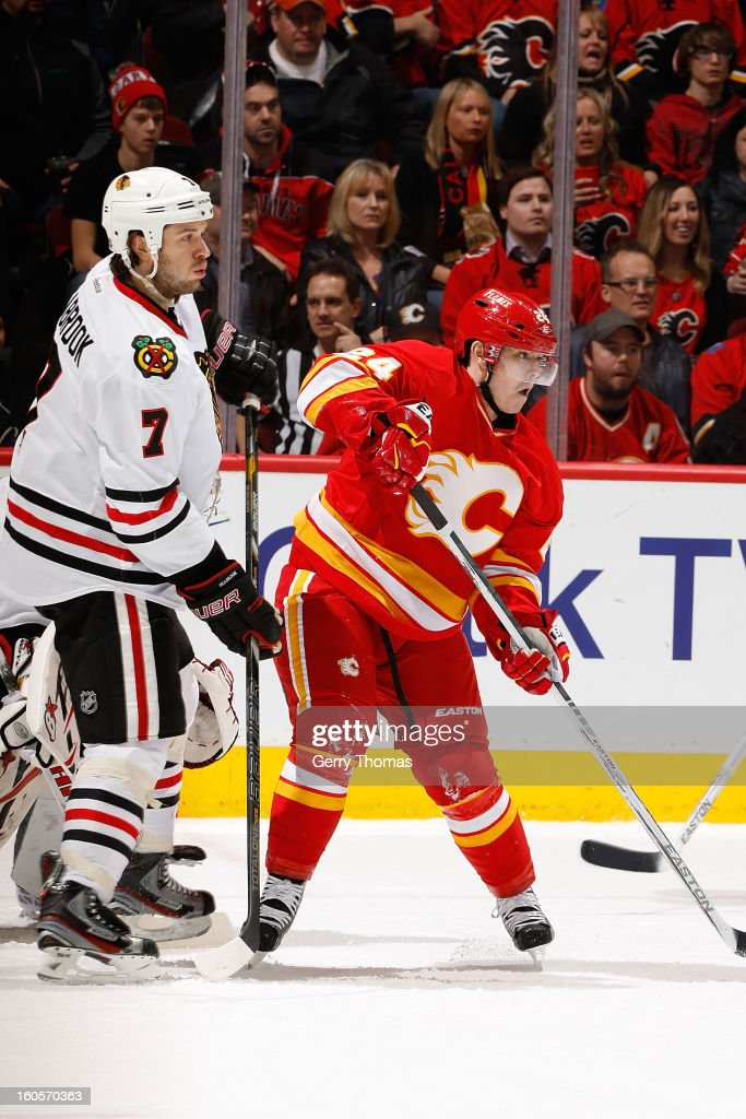 <a gi-track='captionPersonalityLinkClicked' href=/galleries/search?phrase=Jiri+Hudler&family=editorial&specificpeople=2118675 ng-click='$event.stopPropagation()'>Jiri Hudler</a> #24 of the Calgary Flames skates against <a gi-track='captionPersonalityLinkClicked' href=/galleries/search?phrase=Brent+Seabrook&family=editorial&specificpeople=638862 ng-click='$event.stopPropagation()'>Brent Seabrook</a> #7 of the Chicago Blackhawks on February 2, 2013 at the Scotiabank Saddledome in Calgary, Alberta, Canada.