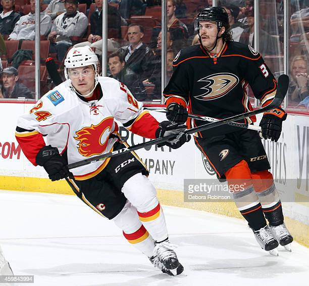 Jiri Hudler of the Calgary Flames skates against Clayton Stoner of the Anaheim Ducks on November 25 2014 at Honda Center in Anaheim California