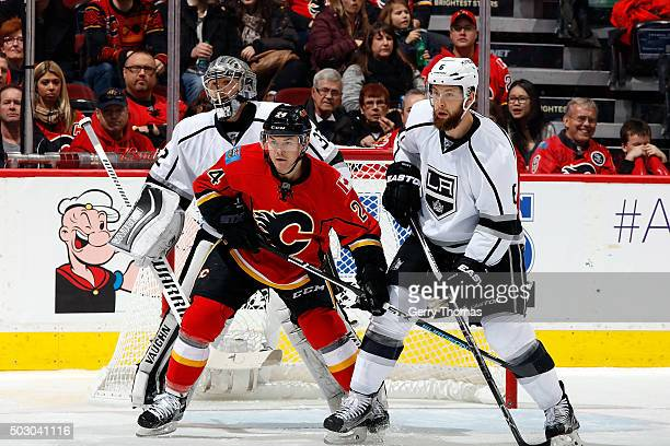 Jiri Hudler of the Calgary Flames skates against Jake Muzzin of the Los Angeles Kings during an NHL game at Scotiabank Saddledome on December 31 2015...