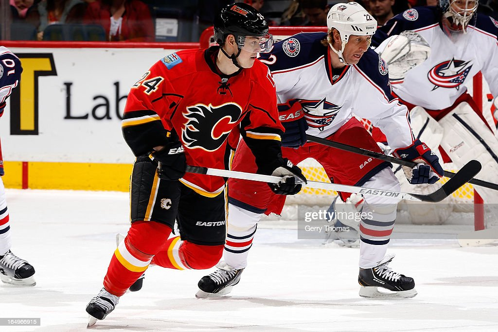 <a gi-track='captionPersonalityLinkClicked' href=/galleries/search?phrase=Jiri+Hudler&family=editorial&specificpeople=2118675 ng-click='$event.stopPropagation()'>Jiri Hudler</a> #24 of the Calgary Flames skates against Vinny Prospal #22 of the Columbus Blue Jackets on March 29, 2013 at the Scotiabank Saddledome in Calgary, Alberta, Canada.