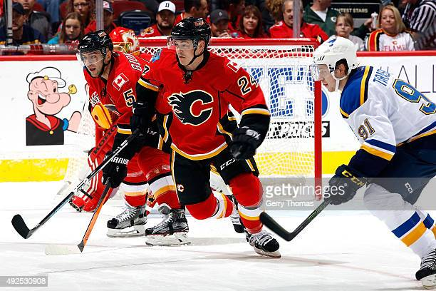 Jiri Hudler of the Calgary Flames skates against Vladimir Tarasenko of the St Louis Blues during an NHL game at Scotiabank Saddledome on October 13...