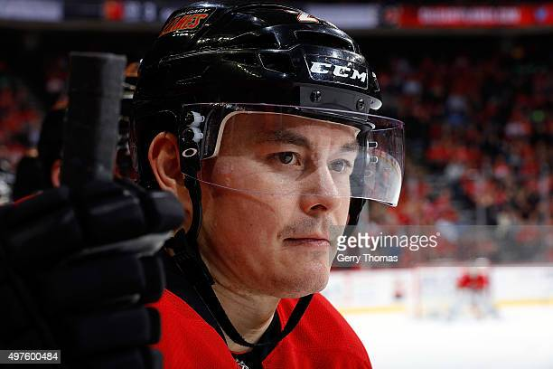 Jiri Hudler of the Calgary Flames skates watches the game in between shifts against the New Jersey Devils during an NHL game at Scotiabank Saddledome...