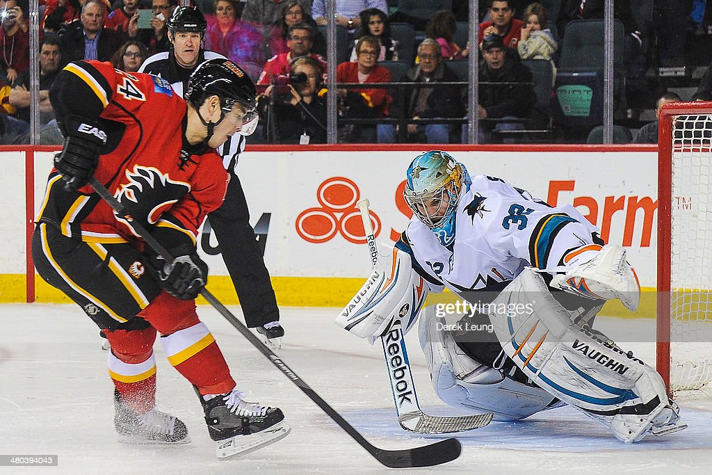 Jiri Hudler #24 of the Calgary Flames takes a shot against Alex Stalock #32 of the San Jose Sharks during shootout at Scotiabank Saddledome on March 24, 2014 in Calgary, Alberta, Canada. The Flames defeated the Sharks 2-1 in shootout.