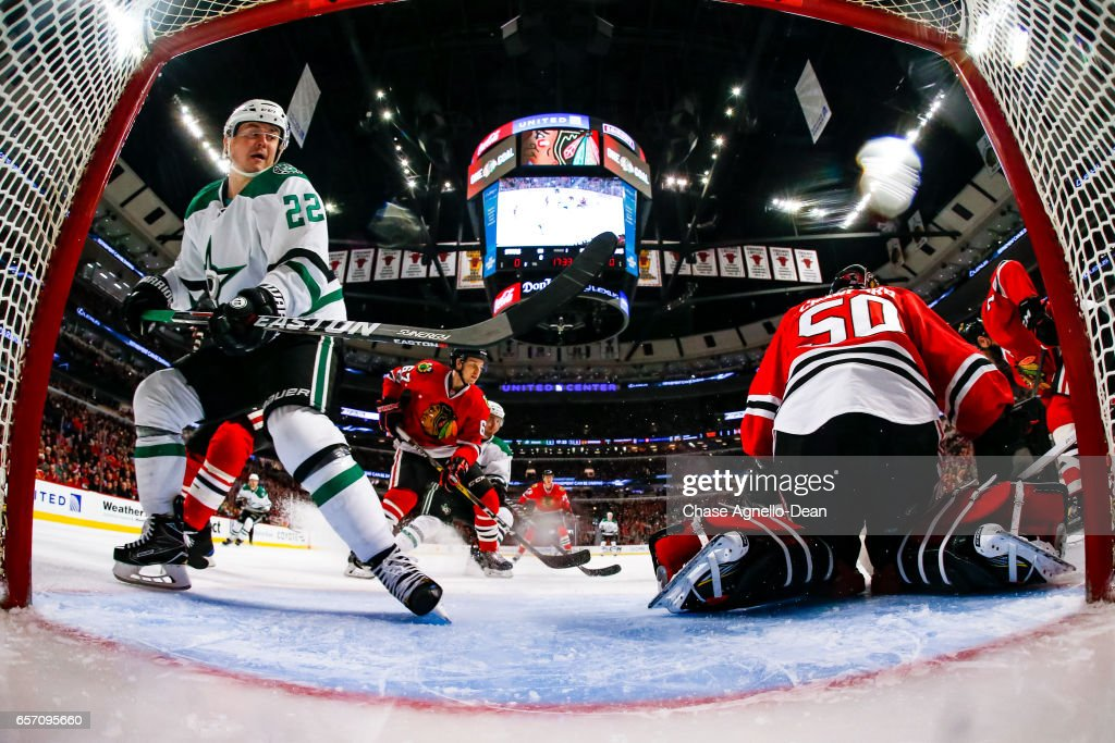 Jiri Hudler #22 of the Dallas Stars watches for the puck next to goalie Corey Crawford #50 of the Chicago Blackhawks in the first period at the United Center on March 23, 2017 in Chicago, Illinois.