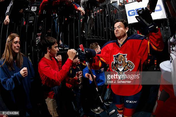 Jiri Hudler of the Florida Panthers is greeted by fans while heading out to the ice prior to the start of the game against the Boston Bruins at the...