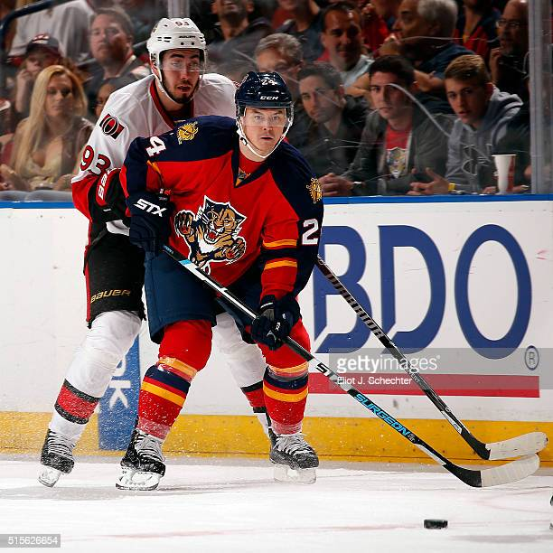 Jiri Hudler of the Florida Panthers skates for possession against Mika Zibanejad of the Ottawa Senators at the BBT Center on March 10 2016 in Sunrise...