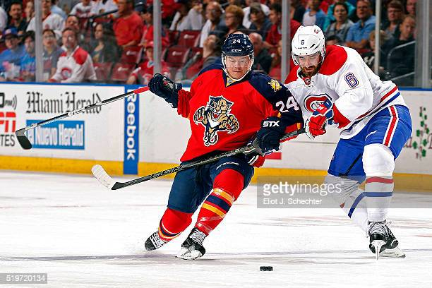 Jiri Hudler of the Florida Panthers tangles with Greg Pateryn of the Montreal Canadiens at the BBT Center on April 2 2016 in Sunrise Florida
