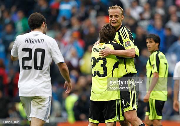 Jiri Jarosik and Leonardo Ponzio of Real Zaragoza celebrate at the end of the La Liga match between Real Madrid and Real Zaragoza at Estadio Santiago...