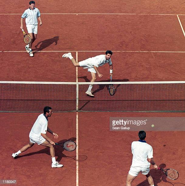 Jiri Novak and David Rykl of the Czech Republic trade volleys with Piet Norval and Wayne Ferreira of South Africa in the doubles match of the two...