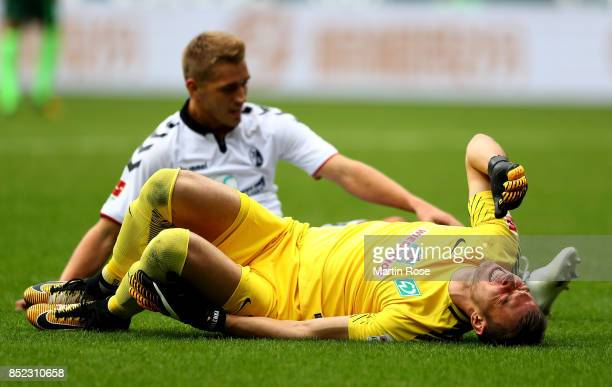 Jiri Pavlenka goalkeeper of Bremen lies injured on the field during the Bundesliga match between SV Werder Bremen and SportClub Freiburg at...