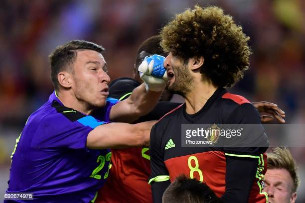 Jiri Pavlenka goalkeeper of Czech Republic hits Marouane Fellaini midfielder of Belgium on the nose during a FIFA international friendly match...