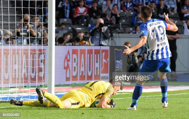 Jiri Pavlenka of Werder Bremen and Vedad Ibisevic of Hertha BSC during the game between Hertha BSC and Werder Bremen on September 10 2017 in Berlin...