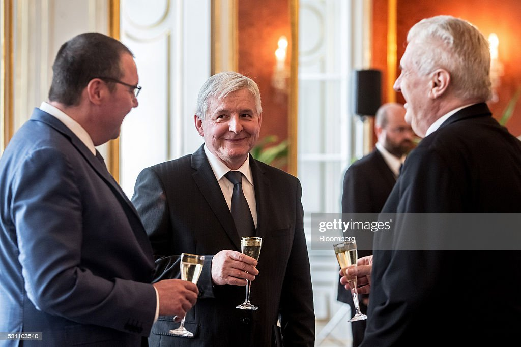 Jiri Rusnok, incoming governor of the Czech central bank, center, Miroslav Singer, outgoing governor of the Czech central bank, left, and <a gi-track='captionPersonalityLinkClicked' href=/galleries/search?phrase=Milos+Zeman&family=editorial&specificpeople=2595776 ng-click='$event.stopPropagation()'>Milos Zeman</a>, Czech president, prepare to toast the new governor's appointment during an official ceremony at Prague Castle in Prague, Czech Republic, on Wednesday, May 25, 2016. Zeman named rate setter Rusnok as central bank governor Wednesday, promoting a long-time ally despite disagreements over the country's unconventional monetary stimulus. Photographer: Martin Divisek/Bloomberg via Getty Images