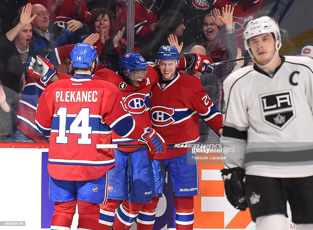 Jiri Sekac #26 of the Montreal Canadiens celebrates with <a gi-track='captionPersonalityLinkClicked' href=/galleries/search?phrase=P.K.+Subban&family=editorial&specificpeople=714418 ng-click='$event.stopPropagation()'>P.K. Subban</a> #76 and <a gi-track='captionPersonalityLinkClicked' href=/galleries/search?phrase=Tomas+Plekanec&family=editorial&specificpeople=620244 ng-click='$event.stopPropagation()'>Tomas Plekanec</a> #14 after scoring a goal against the Los Angeles Kings in the NHL game at the Bell Centre on December 12, 2014 in Montreal, Quebec, Canada.