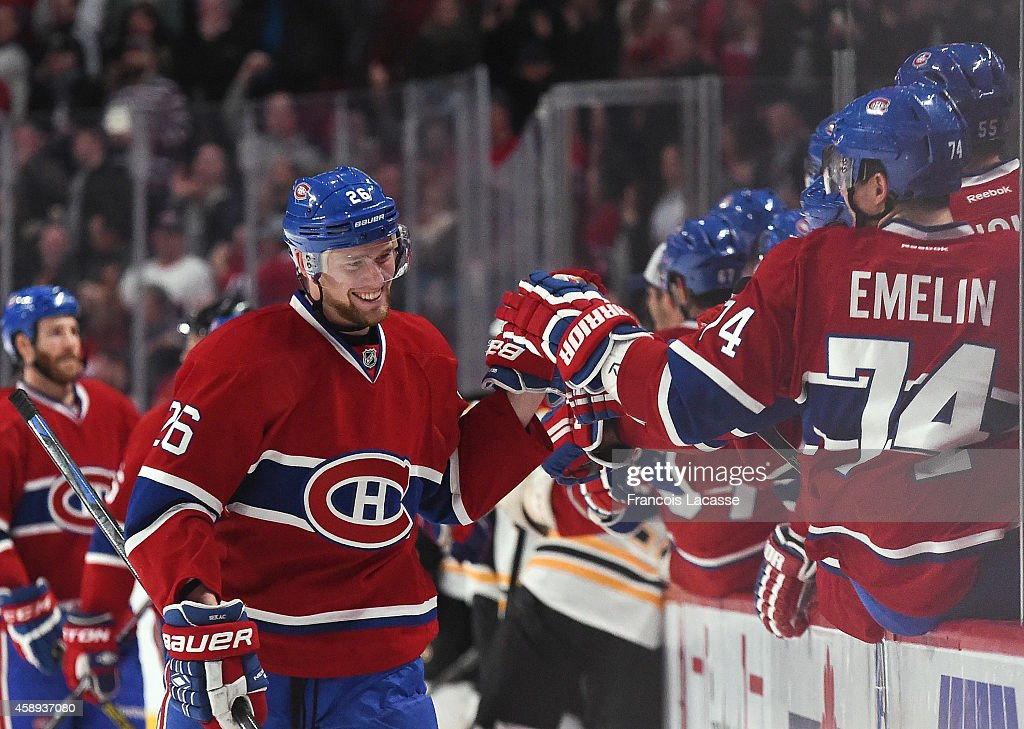 Jiri Sekac #26 of the Montreal Canadiens celebrates with the bench after scoring a goal against the Boston Bruins in the NHL game at the Bell Centre on November 13, 2014 in Montreal, Quebec, Canada.
