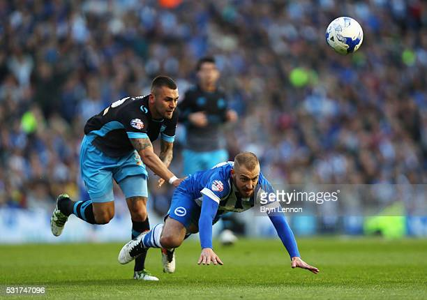 Jiri Skalak of Brighton and Hove Albion is challenged byJack Hunt of Sheffield Wednesday during the Sky Bet Championship Play Off semi final second...