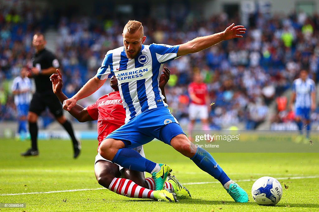 Jiri Skalak of Brighton & Hove Albion battles for the ball with Andy Yiadom of Barnsley during the Sky Bet Championship match between Brighton & Hove Albion and Barnsley at Amex Stadium on September 24, 2016 in Brighton, England.
